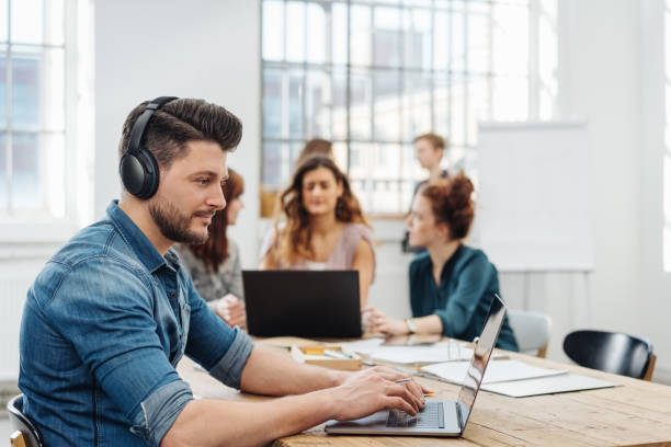 Modern office with a dedicated young business team stock photo