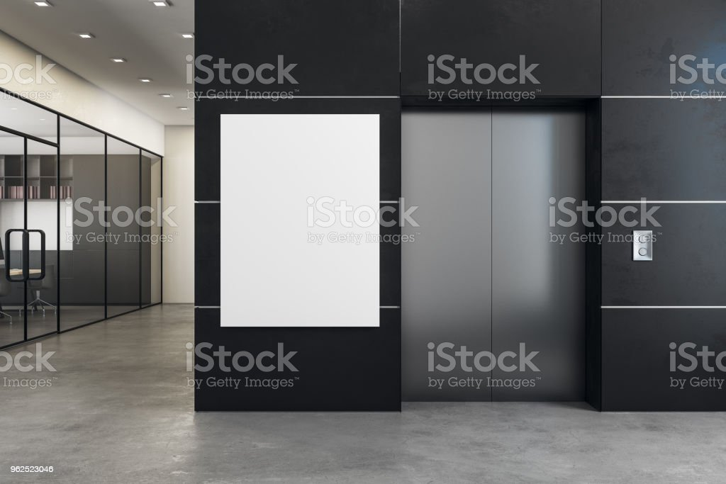 Modern office with elevator and banner stock photo