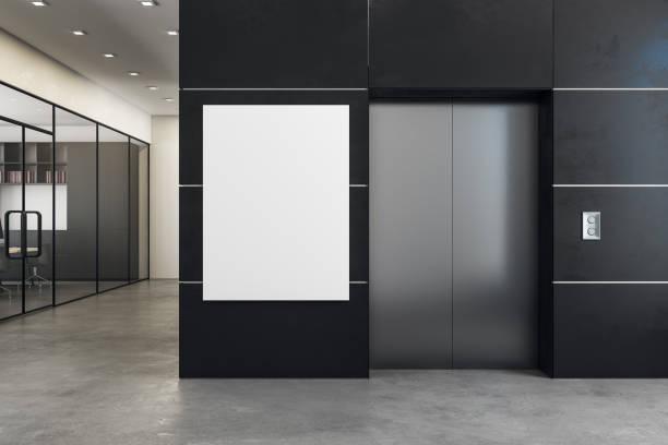 modern office with elevator and banner - ascensore foto e immagini stock