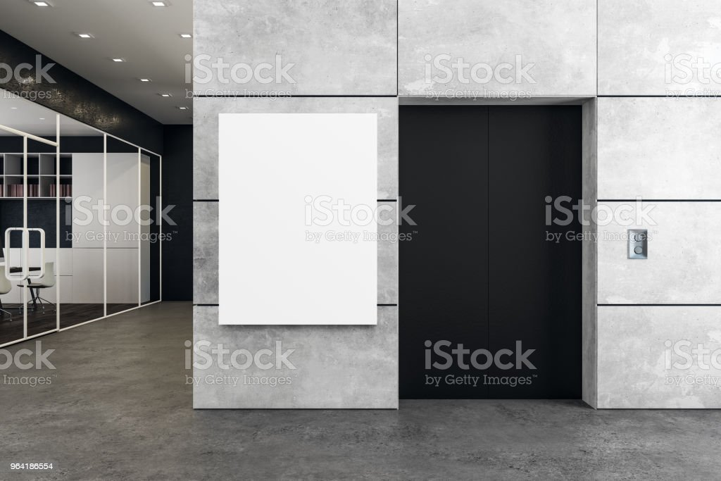 Modern office with elevator and poster stock photo
