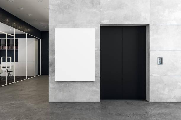 Modernes Büro mit Aufzug und poster – Foto