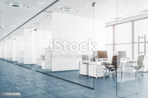 Modern empty office with glass partition walls.