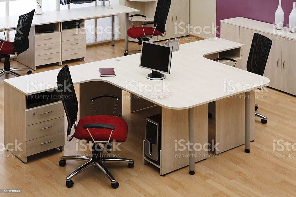A modern office with red seated chairs royalty-free stock photo