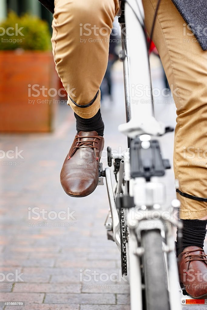 Modern office worker on bicycle stock photo