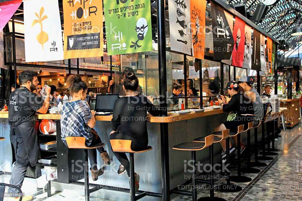 modern open kitchen restaurant in Sarona food market, Tel Aviv stock photo