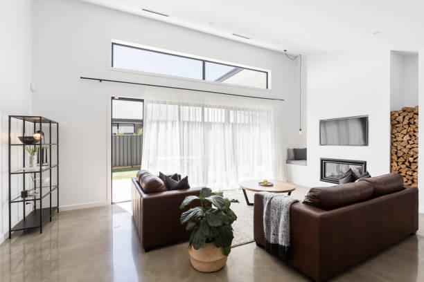 modern open plan luxury living room - betonboden wohnzimmer stock-fotos und bilder