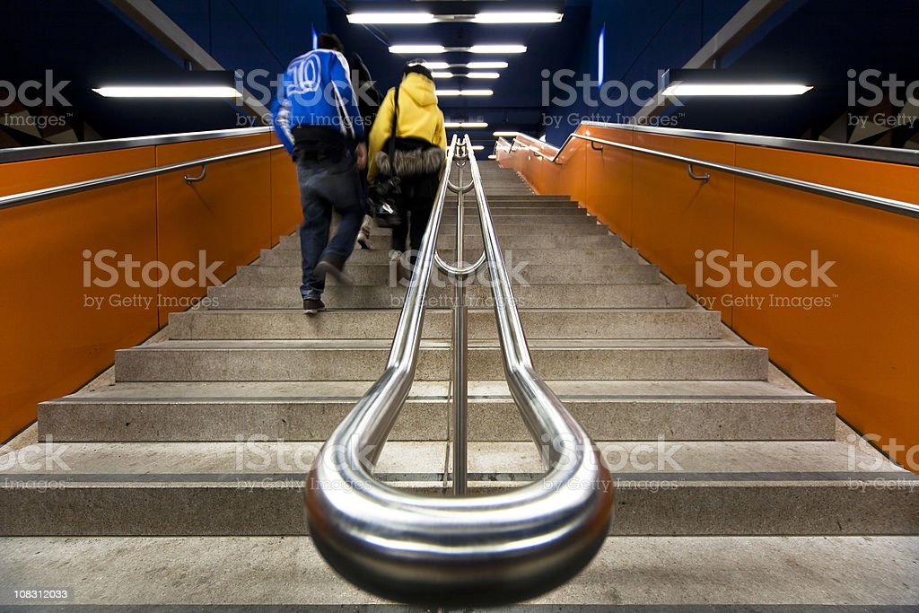modern orange staircase with young commuters royalty-free stock photo