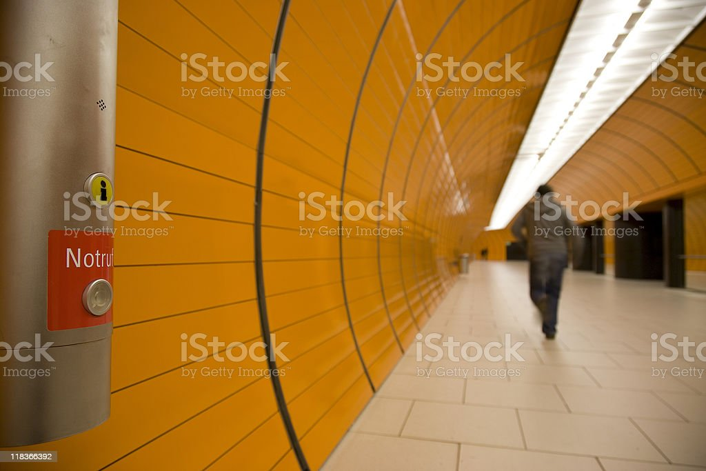 modern orange tunnel with running commuter royalty-free stock photo