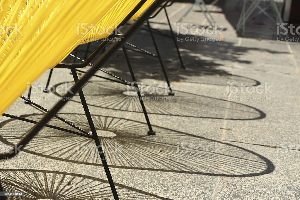 Modern outdoor chairs casting a shadow stock photo