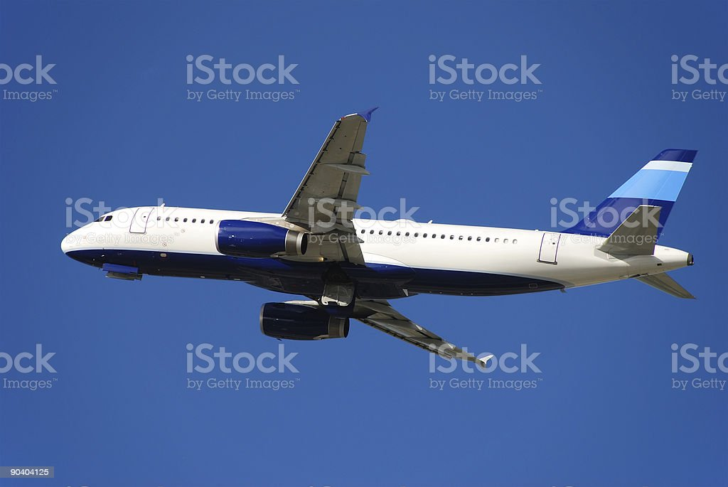 Modern passenger jet taking off stock photo
