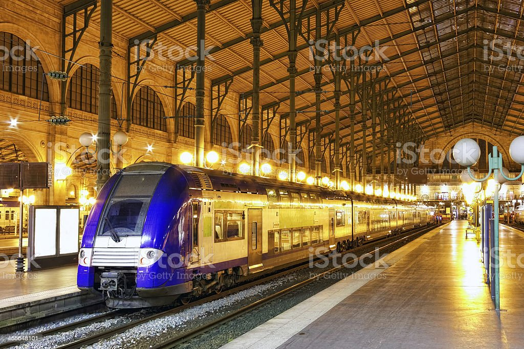 Modern passenger speedway train docking at the station stock photo