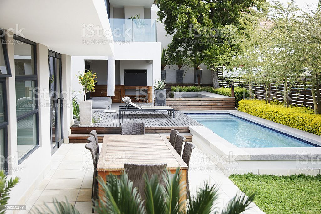 Modern patio next to swimming pool stock photo