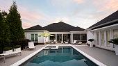 Modern patio overlooking pool.