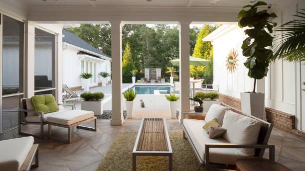 Modern patio overlooking pool. stock photo