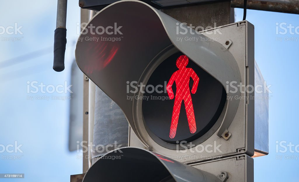 Modern pedestrian traffic lights with red signal stock photo