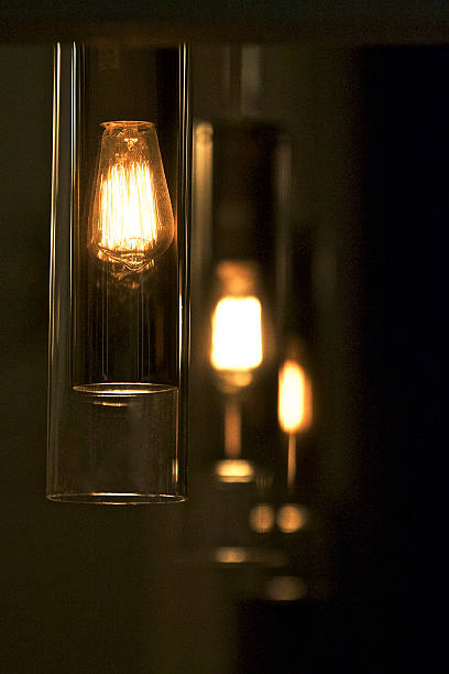 modern pendant lighting - dimly stock pictures, royalty-free photos & images