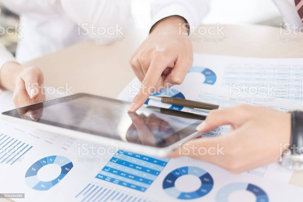 Modern people doing business, graphs and charts being demonstrat stock photo