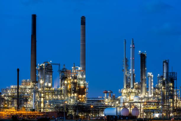 Modern Petrochemical Plant Illuminated at Dusk stock photo