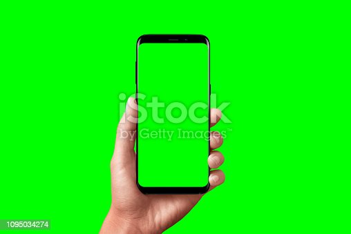 Modern phone in hand isolated. Chroma key for video mockup presentation.