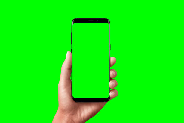 modern phone in hand isolated. chroma key for video mockup presentation. - green screen background stock photos and pictures