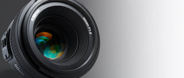 A modern photographic lens with a 50mm focal length on a white background A modern photographic lens with a 50mm focal length on a white background zoom effect stock pictures, royalty-free photos & images