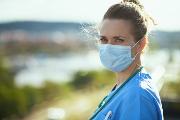 modern physician woman in uniform outside on city street stock photo