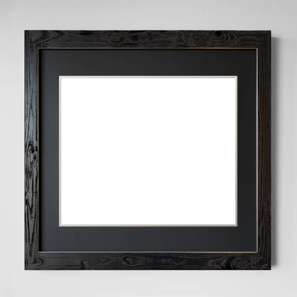 Modern (blank) picture frame hanging on white wall Modern picture frame hanging on white wall. The picture has been cut out, so you can replace it with your own picture. black border stock pictures, royalty-free photos & images
