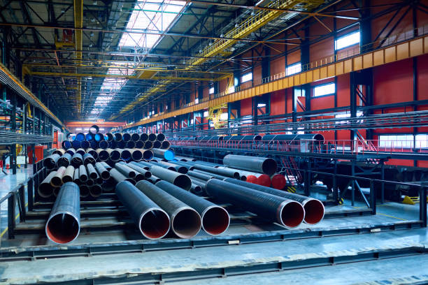 modern pipe-rolling plant with steel tubes - manufacturing stock pictures, royalty-free photos & images