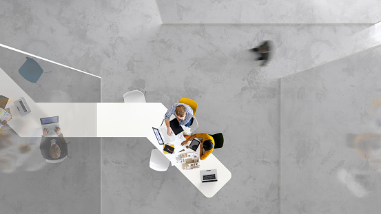 Overhead view of people working in a modern office
