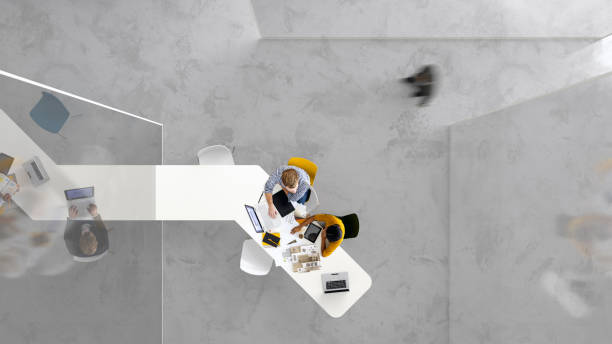 Modern placework Overhead view of people working in a modern office directly above stock pictures, royalty-free photos & images