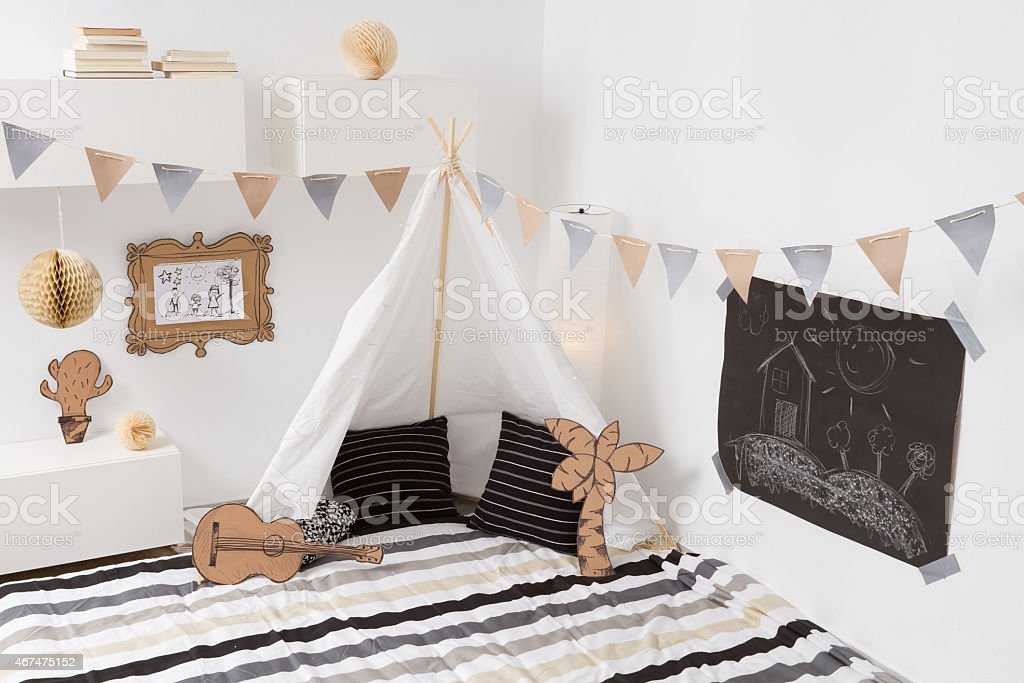 Modern playroom for children with a white teepee stock photo