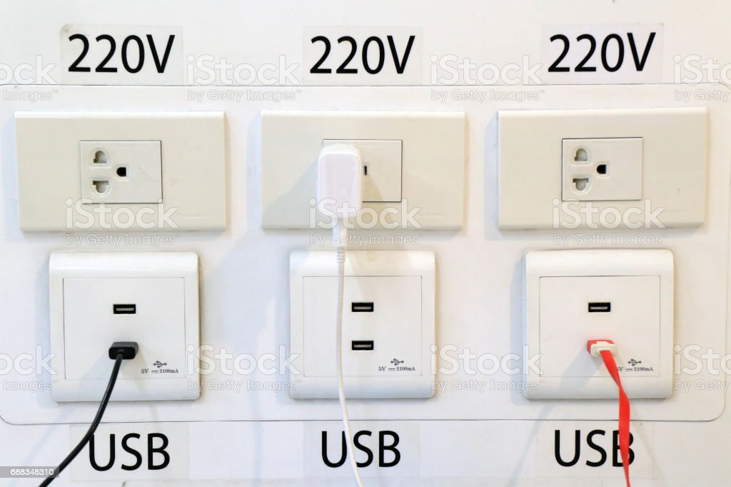 modern plug socket in airport for passengers to charge the phone and poeerbank. Donmuang international airport , Thailand stock photo