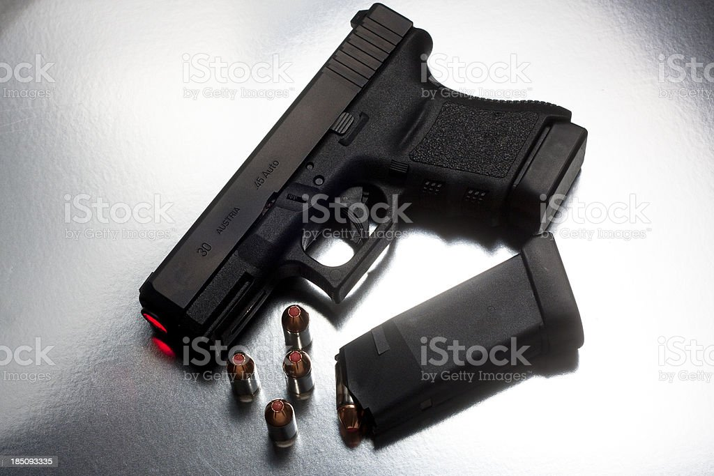 Modern Polymer Handgun - Lighted Barrel with Mag and Bullets royalty-free stock photo