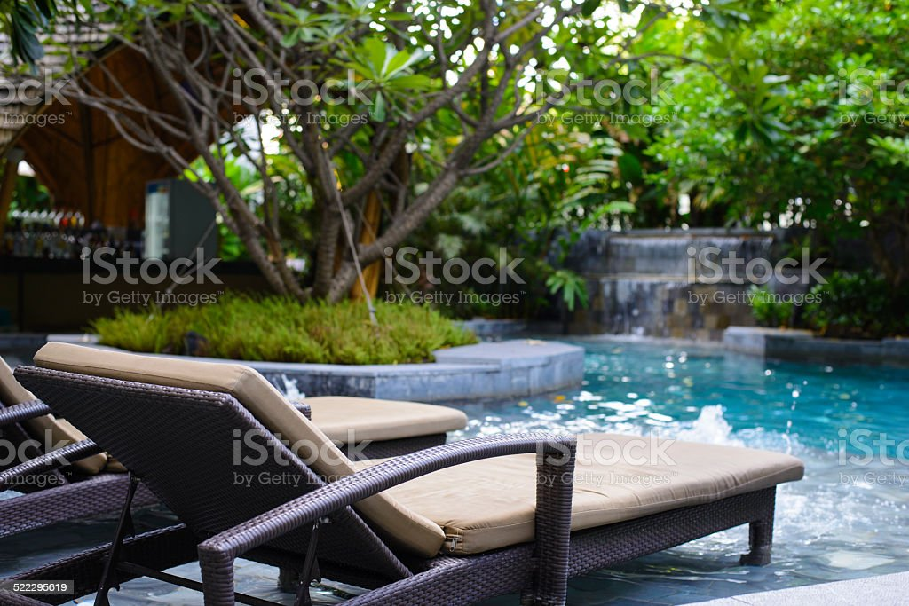 Modern pool with lounge chair stock photo