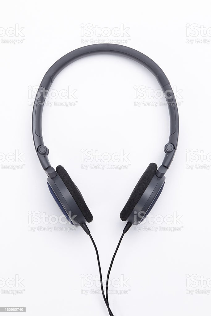 Modern portable audio earphones isolated on a white background royalty-free stock photo