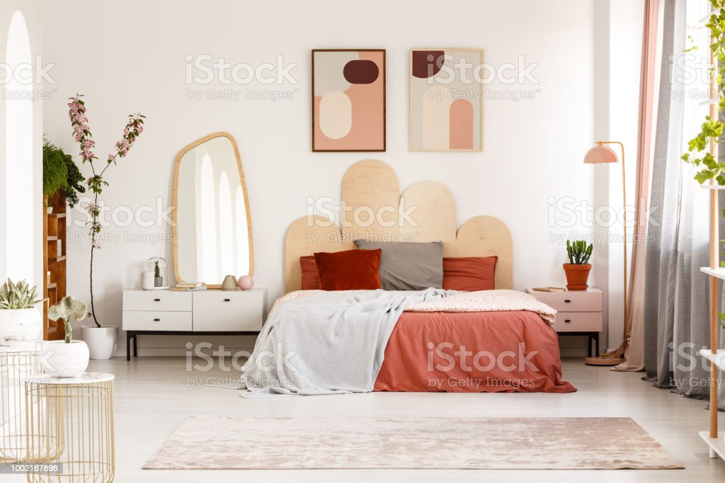 Modern Posters Above Bed With Headboard In Pastel Bedroom Interior With Mirror Real Photo Stock Photo Download Image Now Istock