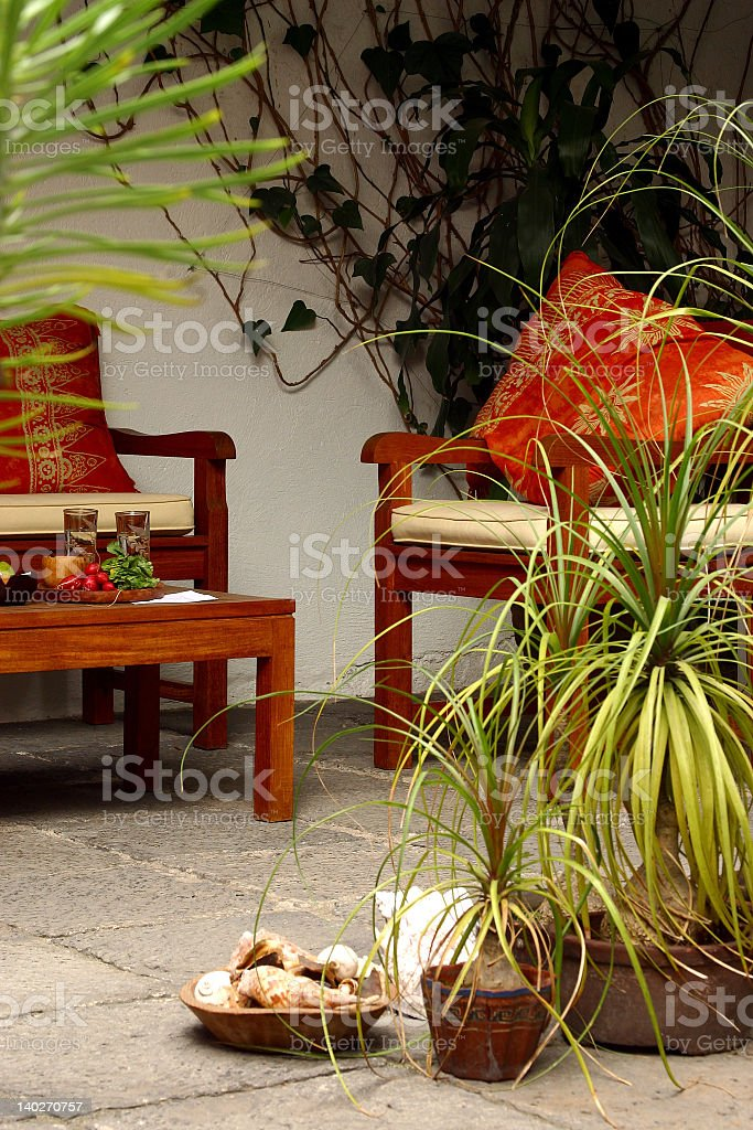 Modern potted plants and furniture on patio royalty-free stock photo