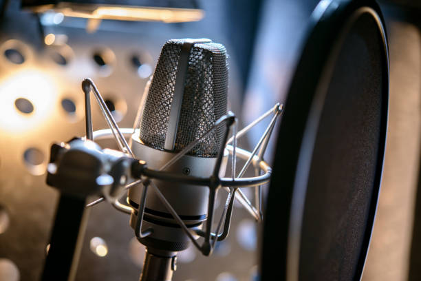 modern professional microphone in recording studio - radio station stock photos and pictures