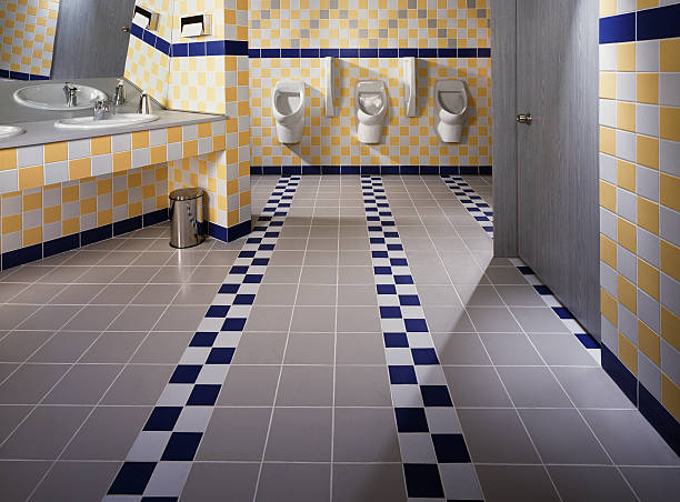 Modern Public Restroom An elegantly tiled public toilet grifare stock pictures, royalty-free photos & images
