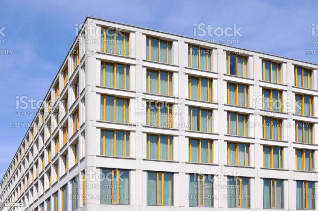 Modern Public White Multistory Building With Yellow Window Frames ...