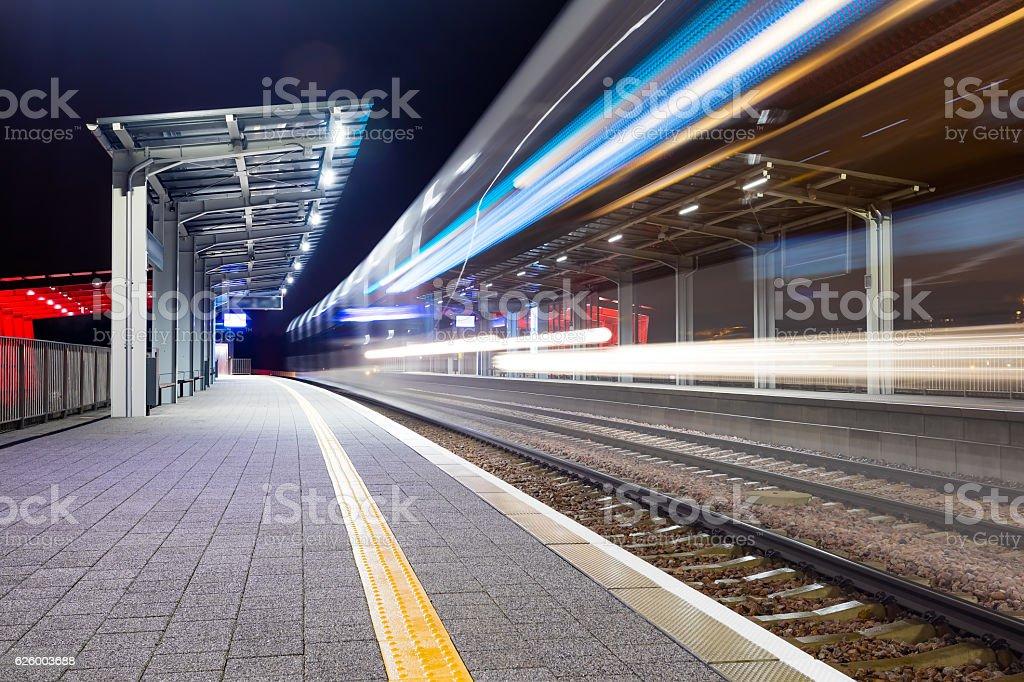 Modern railway train station at night. stock photo