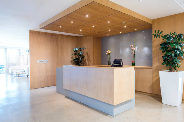 Modern reception area in office Interior of reception. Lights are illuminated above counter. Empty modern office. checkout stock pictures, royalty-free photos & images