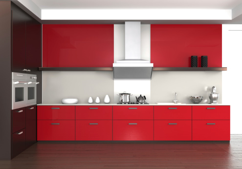 A modern red and white kitchen interior