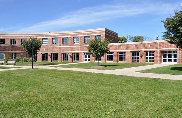 modern red brick school stock photo