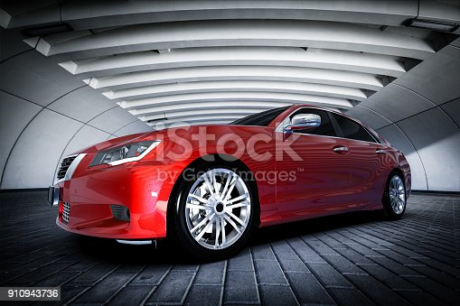 istock Modern red metallic sedan car in urban setting - tunnel. Generic design, brandless 910943736