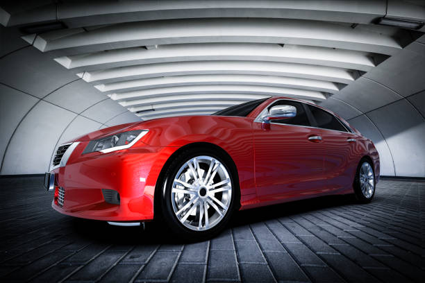 Modern red metallic sedan car in urban setting - tunnel. Generic design, brandless stock photo