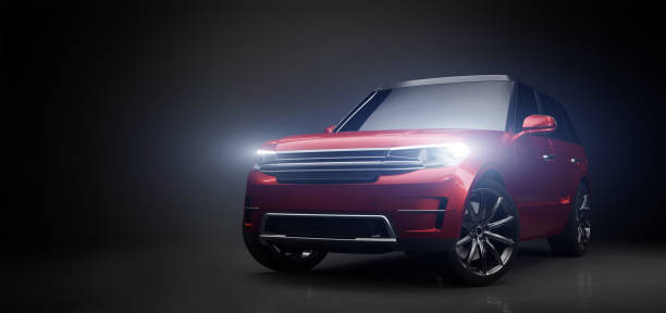 Modern red SUV car in garage with lights turned on stock photo