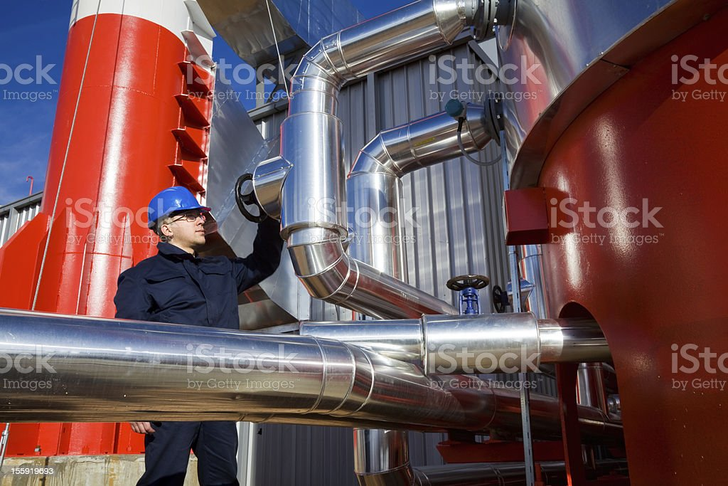 Modern Refinery and Worker royalty-free stock photo