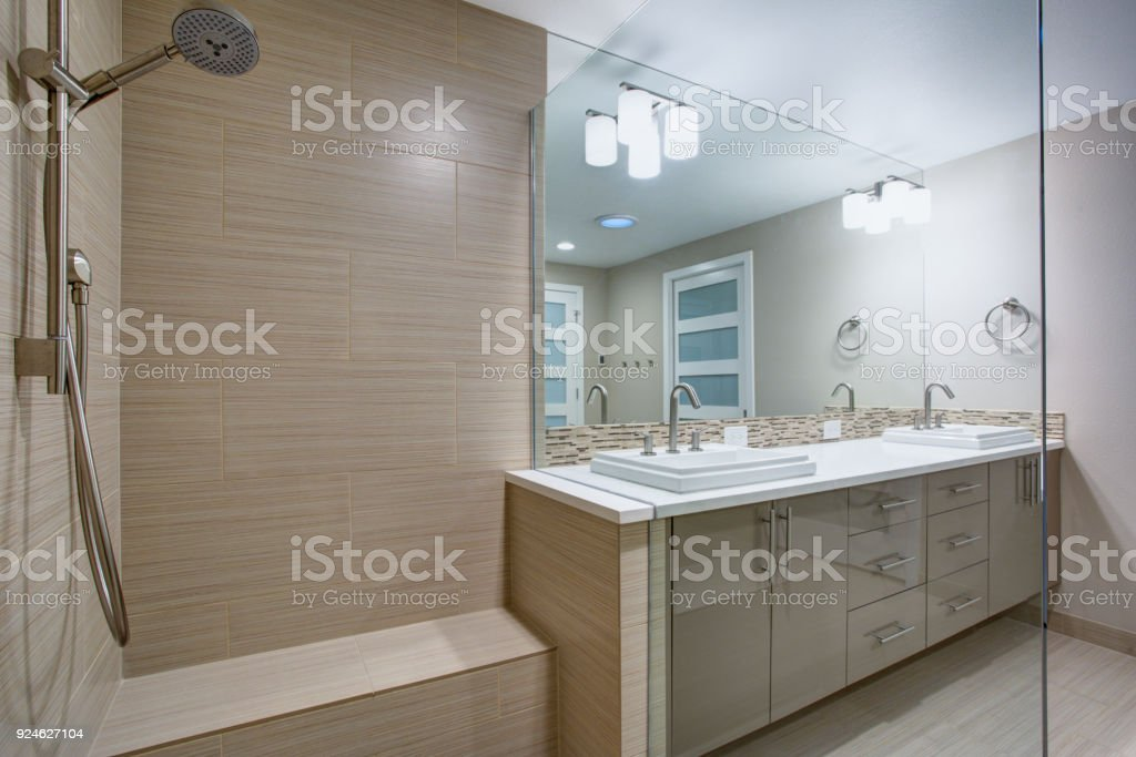 Modern refreshing bathroom with a walk-in shower. stock photo