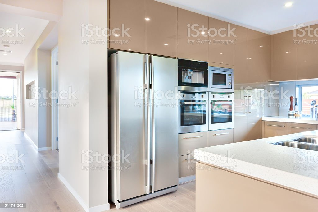 Modern refrigerator in the luxury kitchen with microwave ovens stock photo